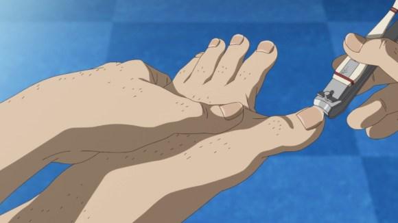 A man clipping his toe-nail off his hairy leg.