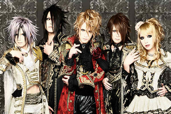 a group shot of five people in visual kei fashion