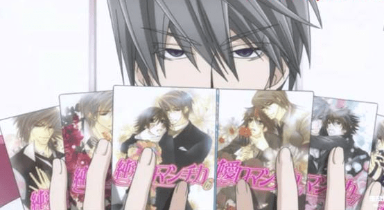 Usagi showing off his BL novels