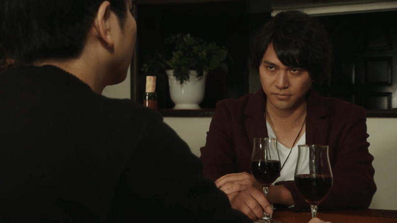 two men having what appears to be a dinner date with wine