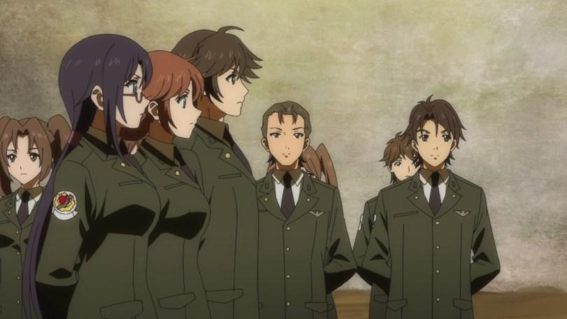 Lieutenant Murata Akiyoshi, Lieutenant Saotome Madoka, and Lieutenant Komaki Sayoko stand at attention during a briefing.