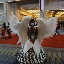 Photo of a cosplayer at Otakon 2021 dressed as an angel
