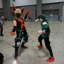 Photo of cosplayers at Otakon 2021 dressed as Deku and Bakugo from My Hero Academia