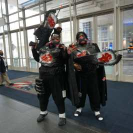 Photo of a cosplayer at Otakon 2021 dressed as characters from Naruto