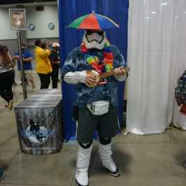 Photo of a cosplayer at Otakon 2021 dressed as a tropical Storm Trooper with an umbrella hat