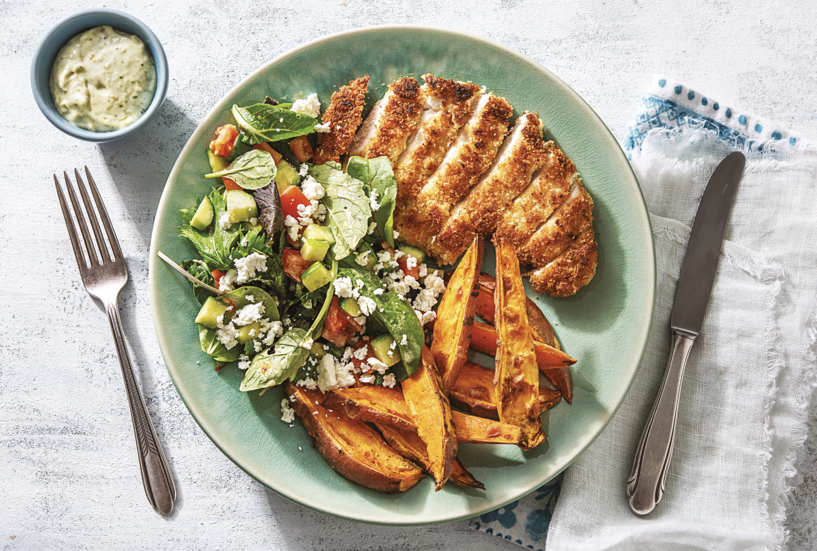 emony Crumbed Chicken with Pesto Dressing & Sweet Potato Wedges