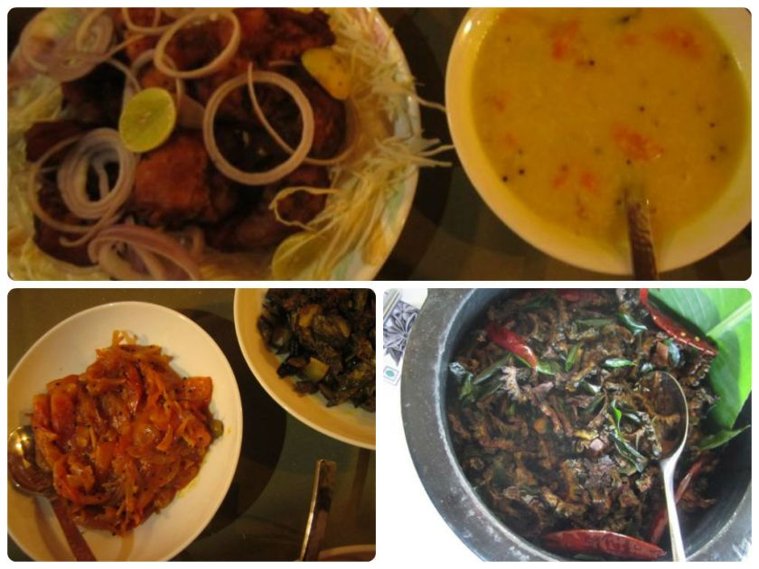 An array of delicious fare including fish fry, dal, tomato/onion relish and karela fry