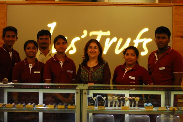 Chenddyna with her staff at Jus' Trufs