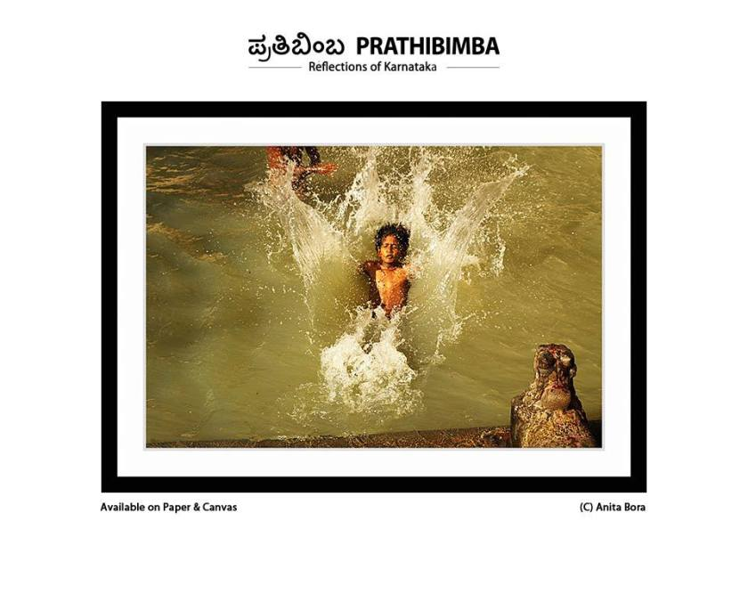 My frame capturing a delight of a little boy jumping into a temple tank at Melkote.
