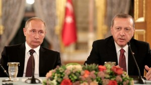 epa05580047 Russian President Vladimir Putin (L) and Turkey's President Recep Tayyip Erdogan (R) sit next to each other as they meet on the sidelines of the 23rd World Energy Congress, in Istanbul, Turkey, 10 October 2016.  EPA/TOLGA BOZOGLU
