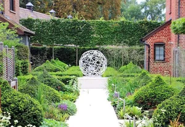 Yew topiary and garden sculpture in luxury boutique garden suites