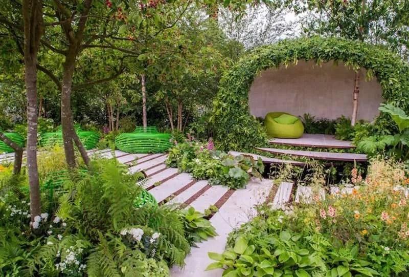 A natural garden building, wildlife planting, urban pond, contemporary tree seats at RHS Hampton Court 2015; Macmillan Garden