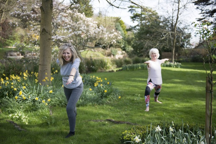 Jane and Annabel practising Yoga for Jane's book, How Not To Get Old