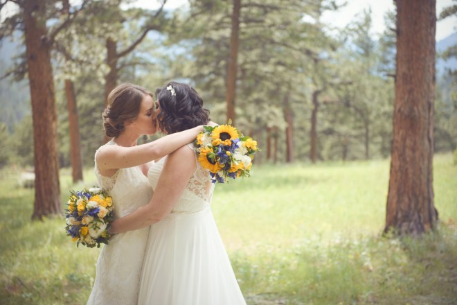 brides kissing in the meadow, Della Terra, Estes Park