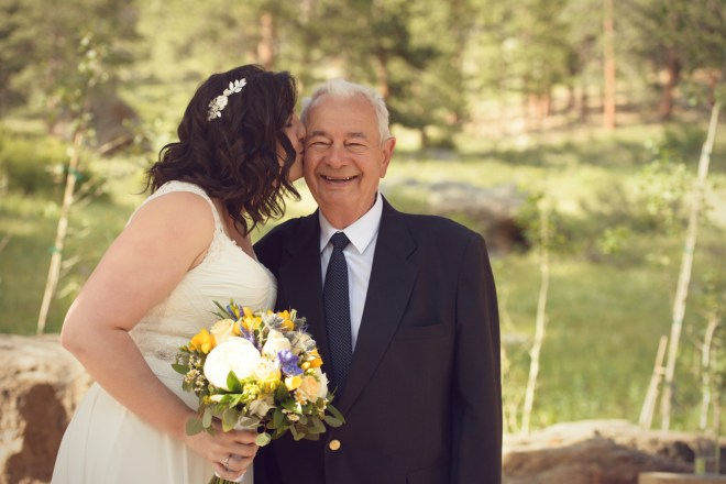 Bride kisses grandfather on cheek