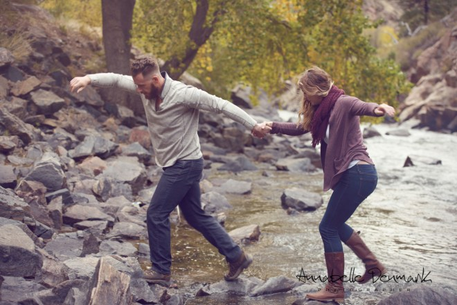 couple cross a river in boots