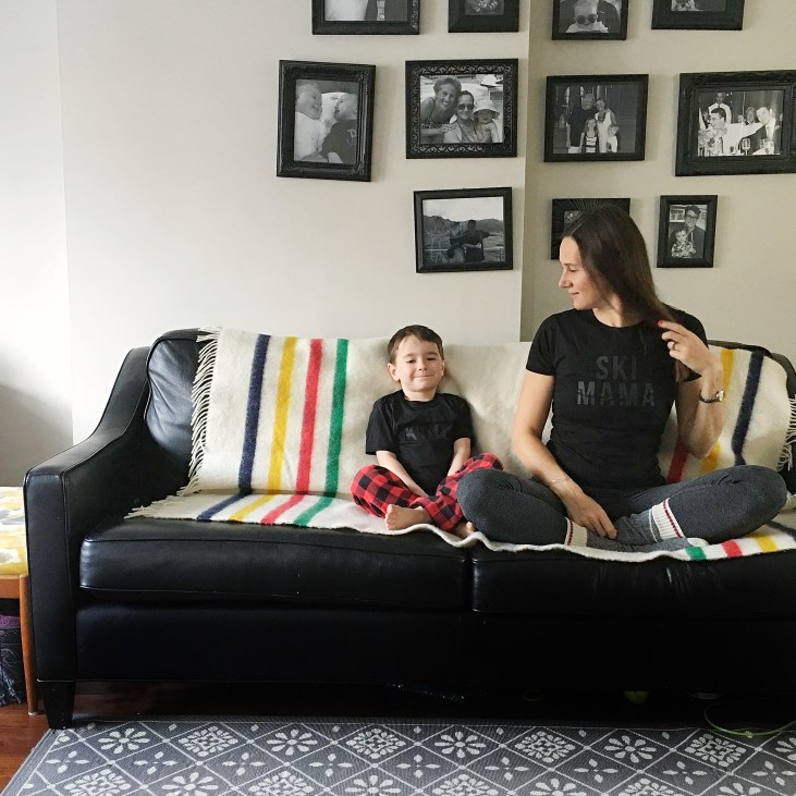 ski family mom and 4 year old son sitting on a couch wearing ski mama and ski kiddo shirts