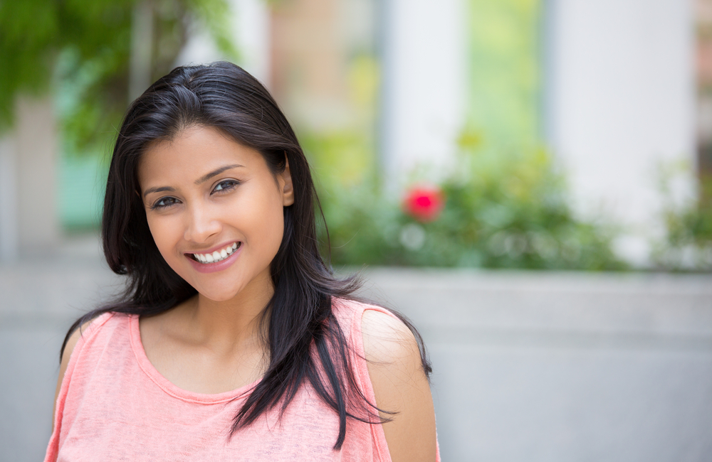young asian woman smiling