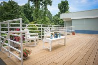 The sunny deck is a great place to sit and enjoy the wooded views.