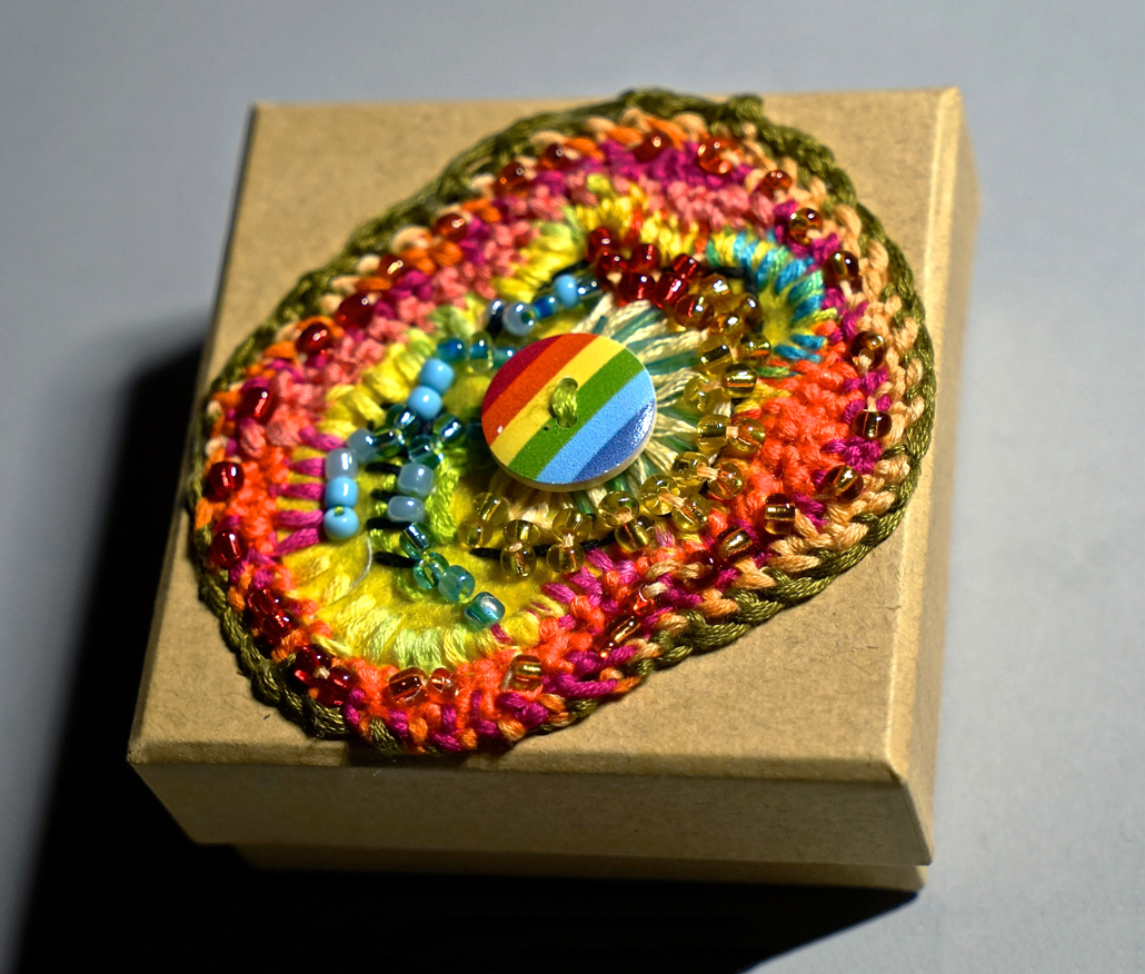 Small square wooden box with rainbow centre