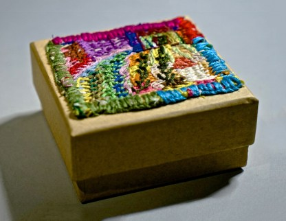 Small square wooden box with shed, garden and coloured border