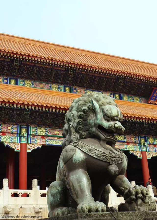 Monumental bronze lions before the Gate of supreme Harmony in the forbidden City Beijing