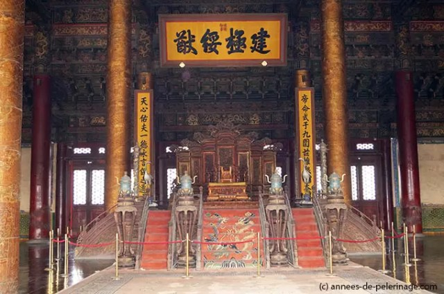 The throne of the chinese Emperors in the Hall of Supreme Harmony in the Forbidden City in Beijing