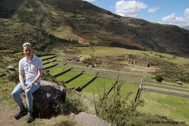 Me visiting tipon and sitting high above with the inca terraces in the background