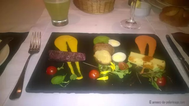 A plate with the starter of the dinner menu at belmond sanctuary lodge