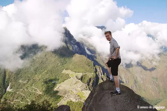 Standing on the peak of wayna picchu and enjoying the view on Machu Picchu