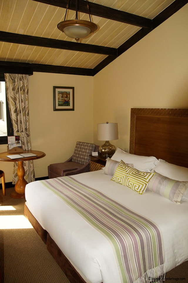 Room with king size bed of the belmond sanctuary lodge in machu picchu
