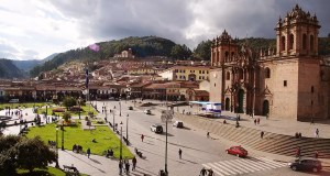 The beautiful Plaza de Armas bathed in golden sunlight in Cusco, Peru