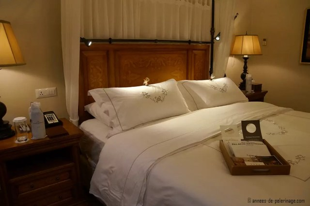 The huge luxurious double bed at the Belmond Palacio Nazarenas in Cusco