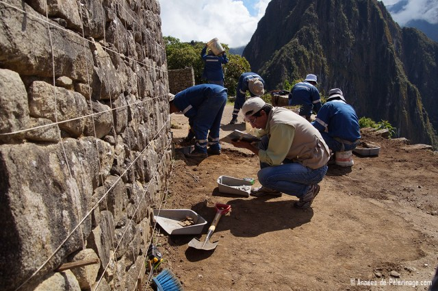 Archeologist working on a wall studying the Machu Picchu architecture
