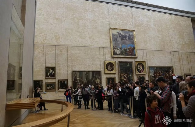The crowd in front of the Mona Lisa in Louvre Paris