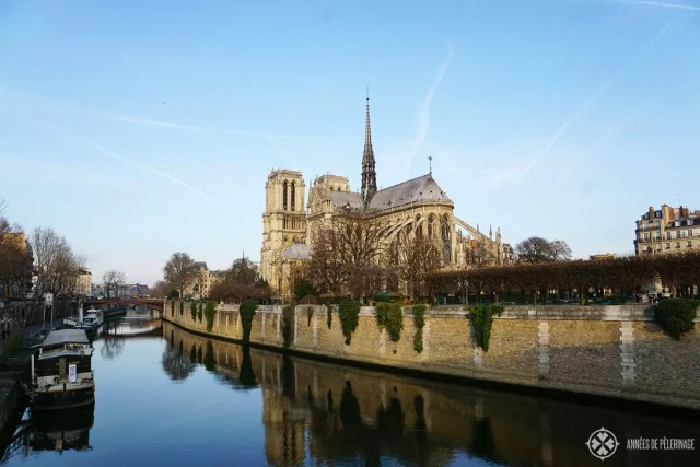 Notre-Dame de Paris in the morning light with the seine in the foreground