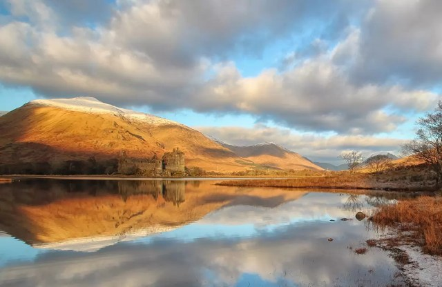 Kilchurn Castle in the early morning light near Oban, Scotland by john mcsporran