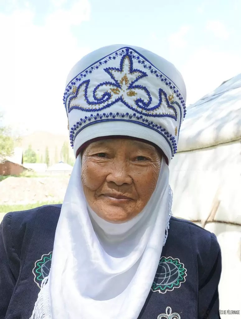 An old Kyrgyz woman in her traditional headdress. She is specialized on embroidery and felt making
