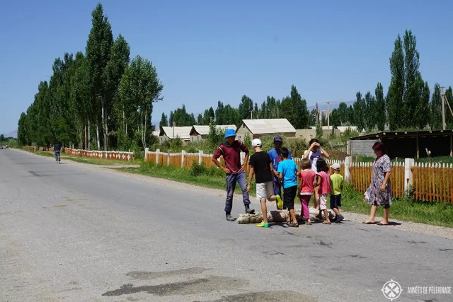 A family making felt on the streets of kyrgyzstan. This is actually the traditional way - rolling it over and over for hours.