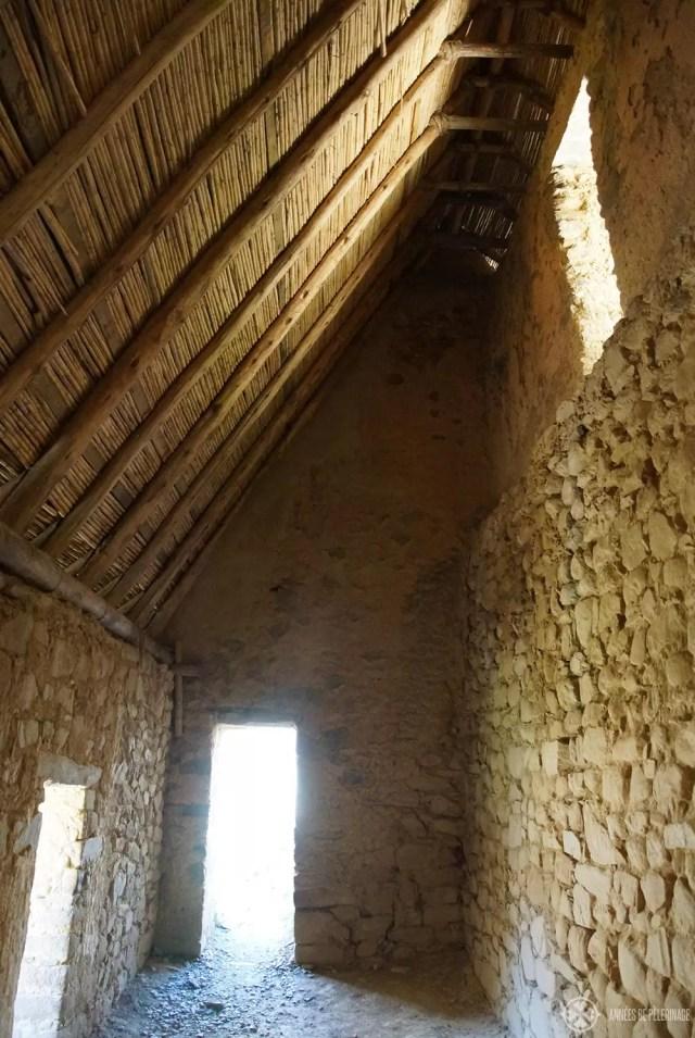 Inside an ancient granary in Ollantaytambo, Peru