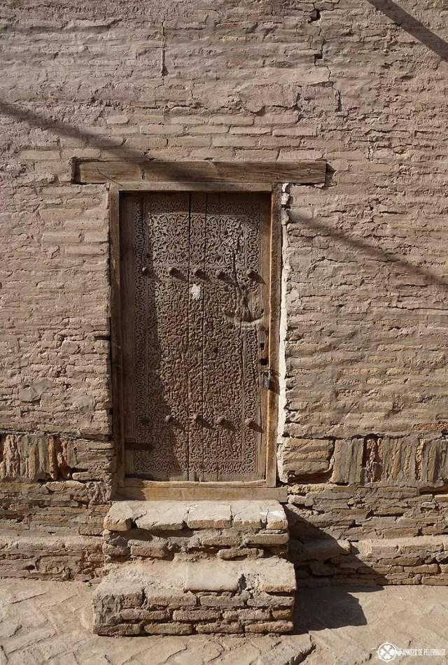 A traditional carved wood door in Khiva, Uzbekistan