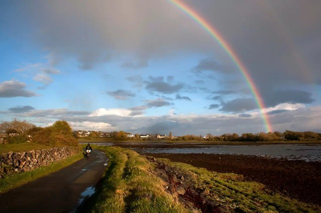 Rainbow over Mweeloon Bay, Ireland. If you plan to take a bike tour, you really should bring a poncho, as you can see.