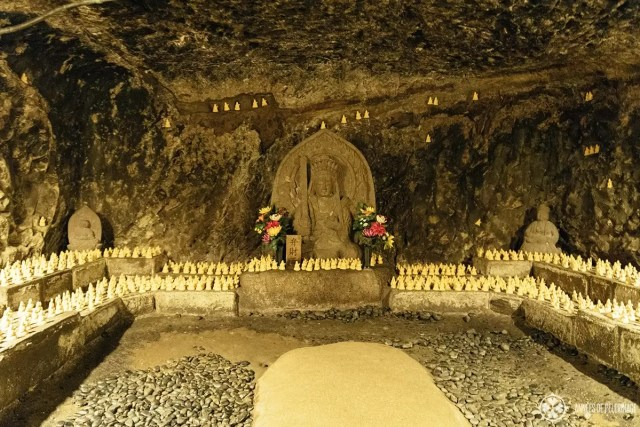 A cave at Hase-Dera temple with a statue of the goddess Benzaiten in Kamakura, Japan