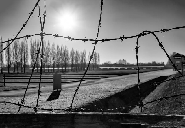 Dachau concentration camp as seen through the mesh wire fence