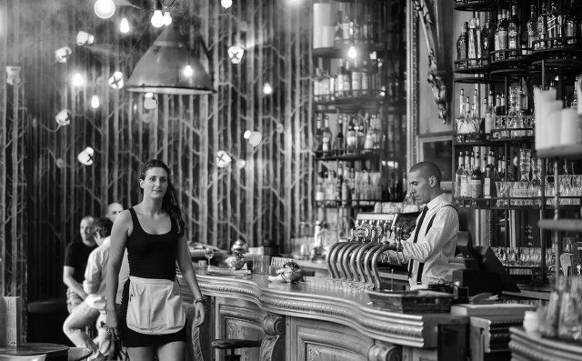 a waitress in a bar. Is she in italy? Japan? US? Depending on the country you may have to tip her or insult her by doing so!