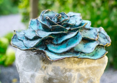 Rose bronze blue patinated on alabaster