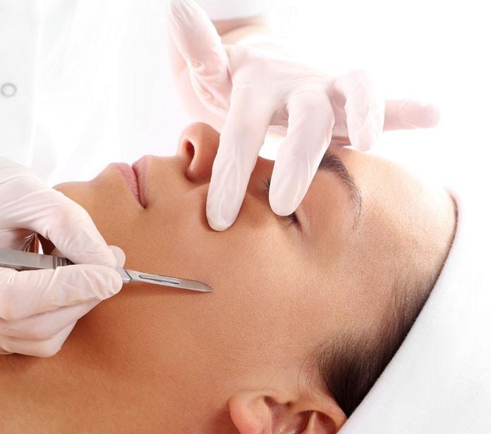 lady at beauty salon having a dermaplaning treatment