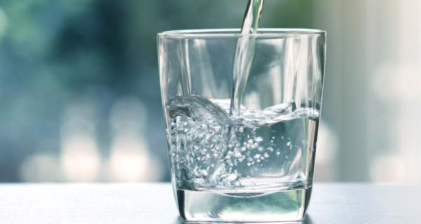 Glass With Water Being Poured Into It