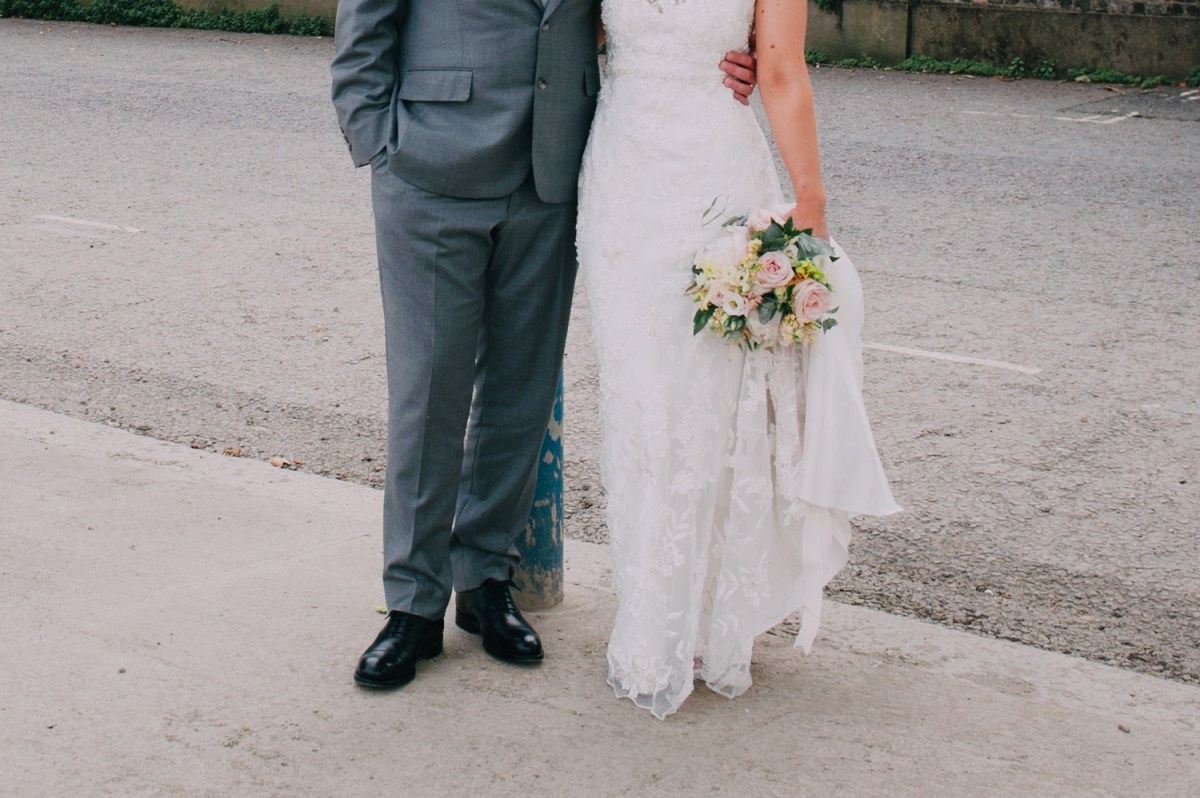 boho bride and groom with pastel eucalyptus bouquet outside london rowing club