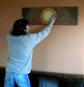 Our blind friend discovering the painting by touching it